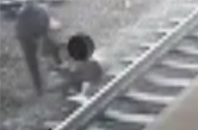 Police officer pulls man off tracks moments before train arrives