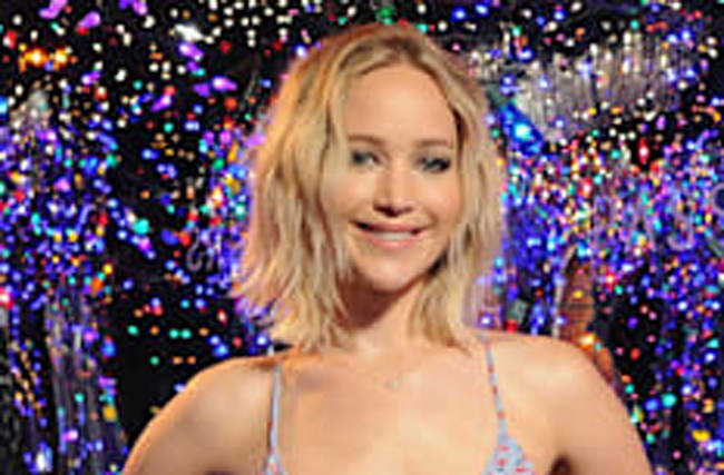 Jennifer Lawrence apologises over sacred rock bum scratch