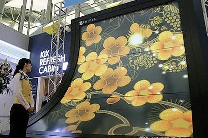 World's largest curved plasma display flows into Japan's Kansai airport