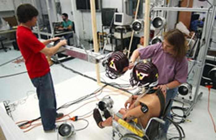 Virginia Tech football helmets monitor hits wirelessly