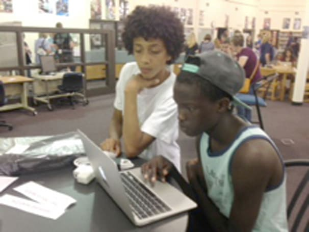 Iowa high school delivers 1,425 MacBook Airs to students
