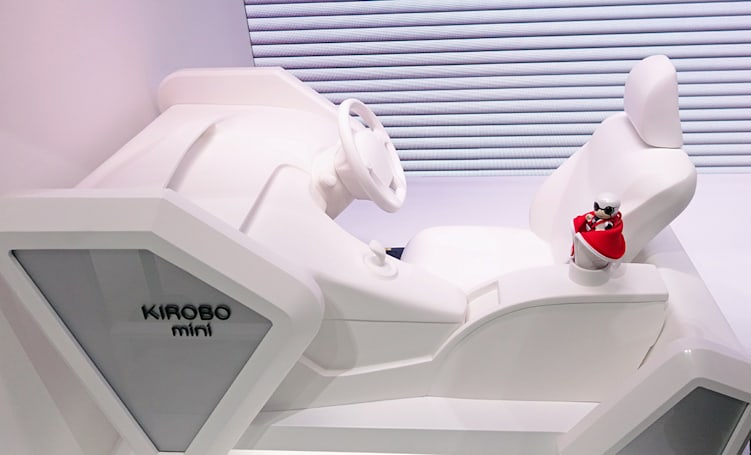 Toyota's tiny robot companion fits in your car's cup holder