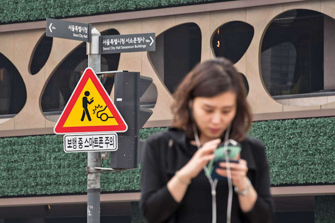 South Korea hopes traffic signs will cut phone distractions