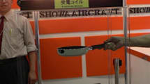 Showa Aircraft shows off contactless charging system, world backs on up a little