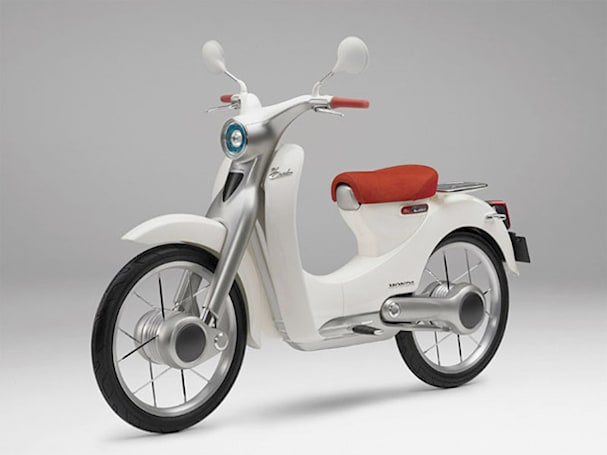 Honda's timeless Super Cub motorcycle showcased with a touch of EV