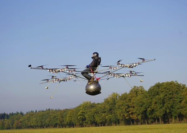 First manned multicopter takes flight, brave human sits amidst blades (video)