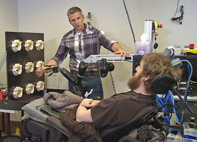 Neural implants and robot arms allow paralyzed man to feel again