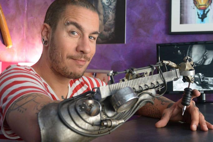 Tattoo artist's prosthetic inking arm is better than a real hand