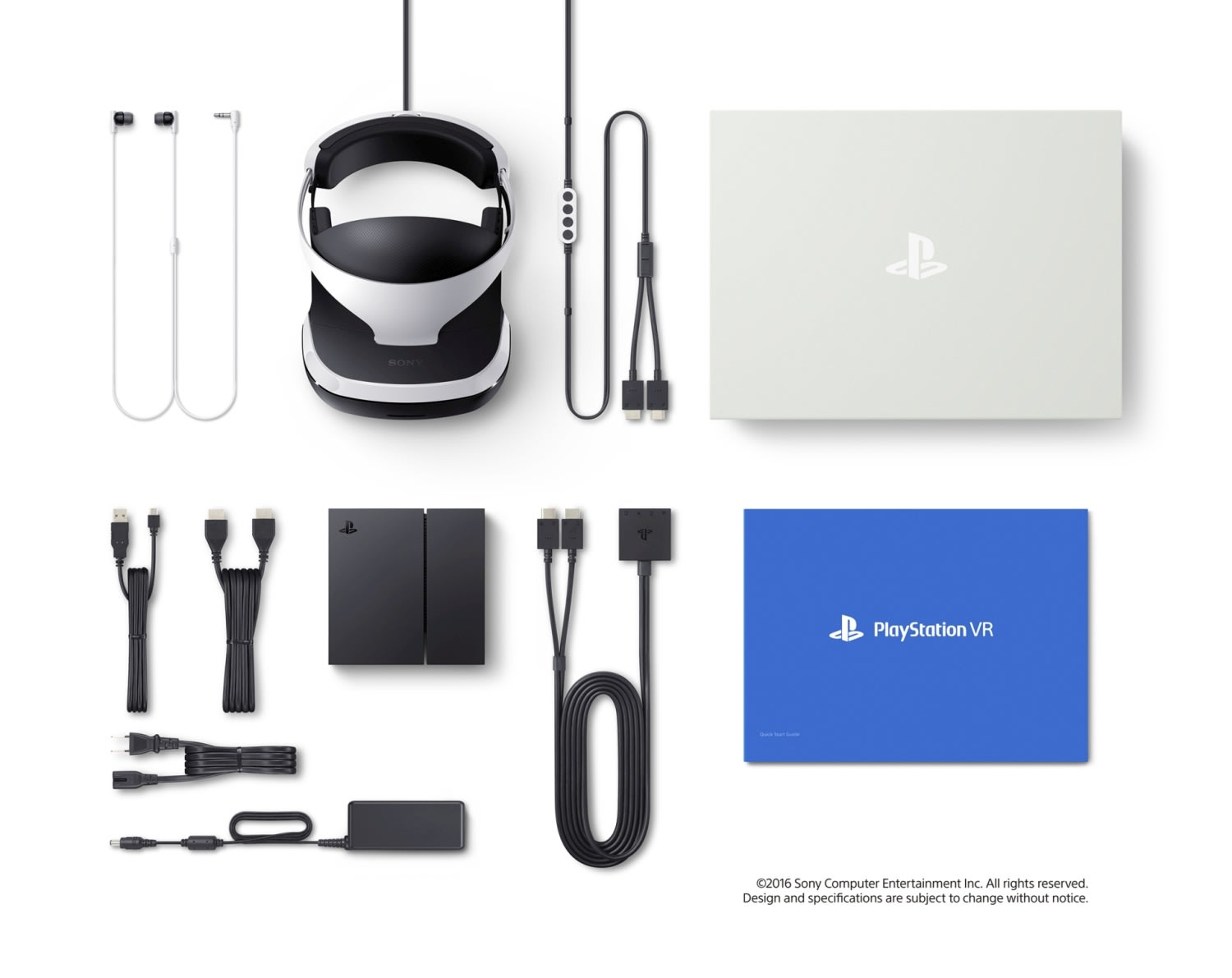 contents of PS VR unboxed on white background