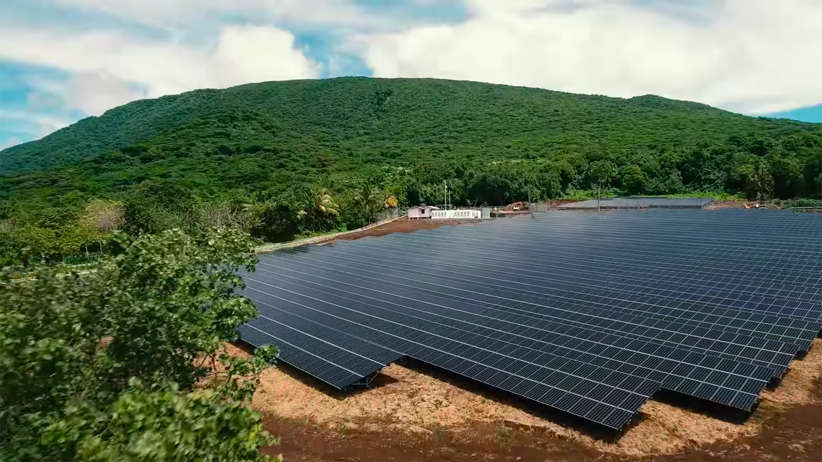 Solar Power On The Island Of Tau A Preliminary Appraisal Energy Fair Project Idea Calculation Exercise For Battery Charger Image Below Shows Installation Panels Are Fixed And Oriented At Shallow Angle To North Presumably Or Around 14 Degrees