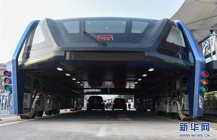 China's elevated bus demoed with cars driving underneath