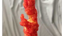 iPhone-yielding, Pope-shaped Cheetos curl will forever change your view of the cheesy snack