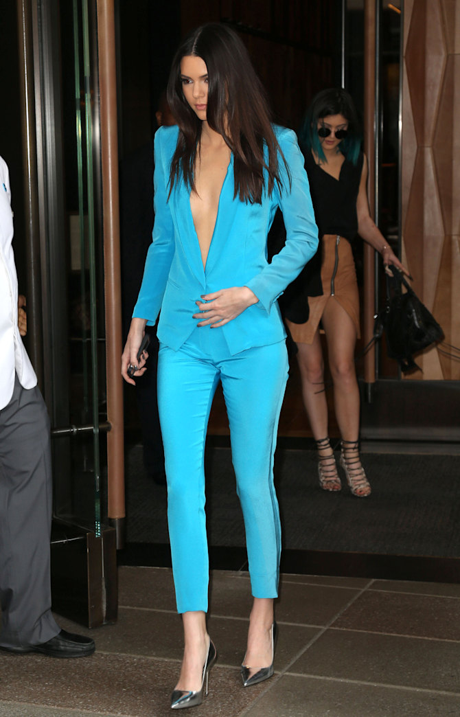 Kendall Jenner flaunts deep cleavage in plunging pantsuit