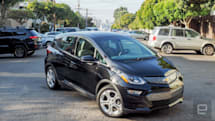 Chevy delivers its first Bolt EVs in Tesla's backyard