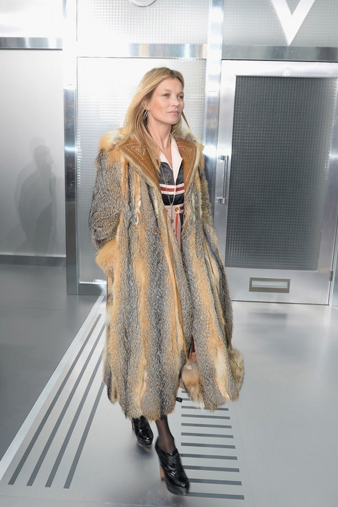 Kate Moss wears the biggest fur coat ever, probably