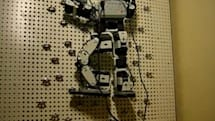 Bioloid robot goes climbing on its own, will one day rip you from your hiding tree