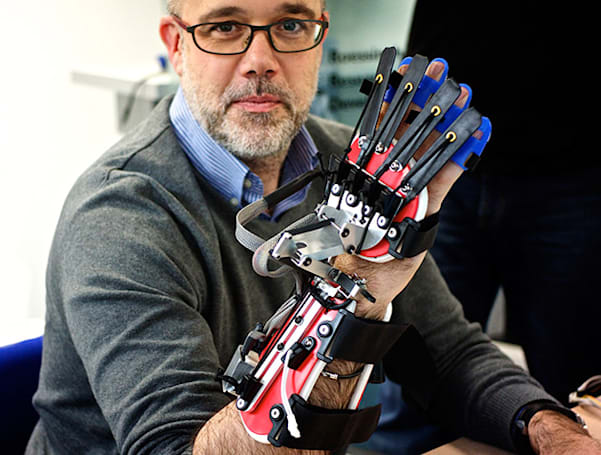 Robotic glove and games help patients regain control of their hands