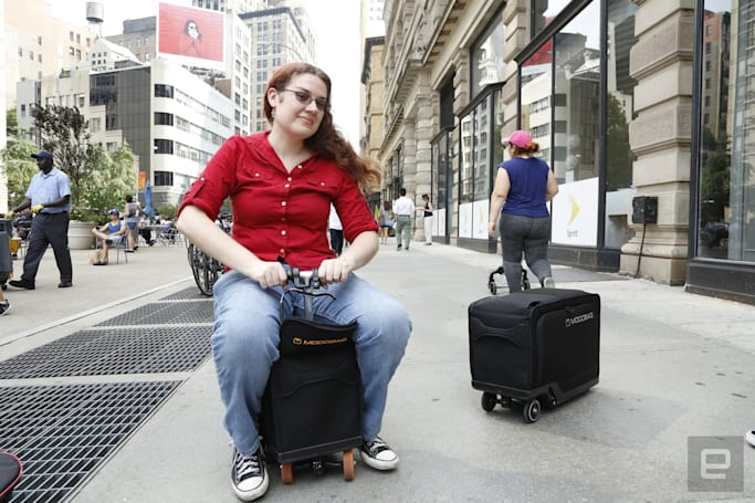 Cruise the airport on top of a piece of motorized luggage