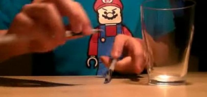 Pen tapping along with the Super Mario song
