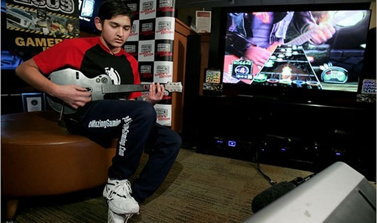 14-year-old breaks GHIII 'Fire and Flames' record, guitars