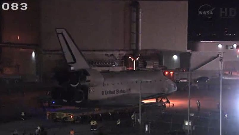 Watch Space Shuttle Atlantis' final journey to the Kennedy Space Center visitor building (video)