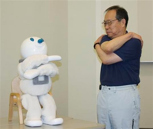 Video: Taizo the robot teaches grandpa how to stretch, so you don't have to