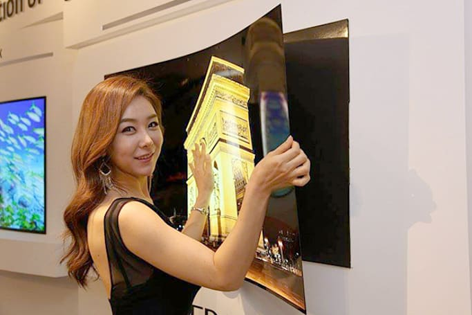 LG's super-thin OLED screen sticks to your wall using magnets