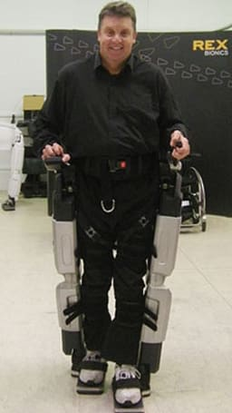 New Zealand paralympian buys first Rex Bionics exoskeleton, takes robot walking legs for a spin