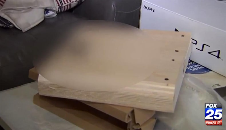 Kid opens PS4 on Christmas day, finds block of wood instead
