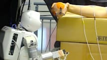 Researchers give a robot the ability to control a person's arm (video)