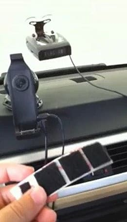 iPhone 4 and TomTom Car Kit brought together with velcro