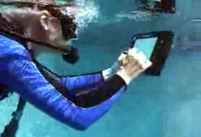 xTablet T8700 left alone in a pool with stranger, does indeed work under water