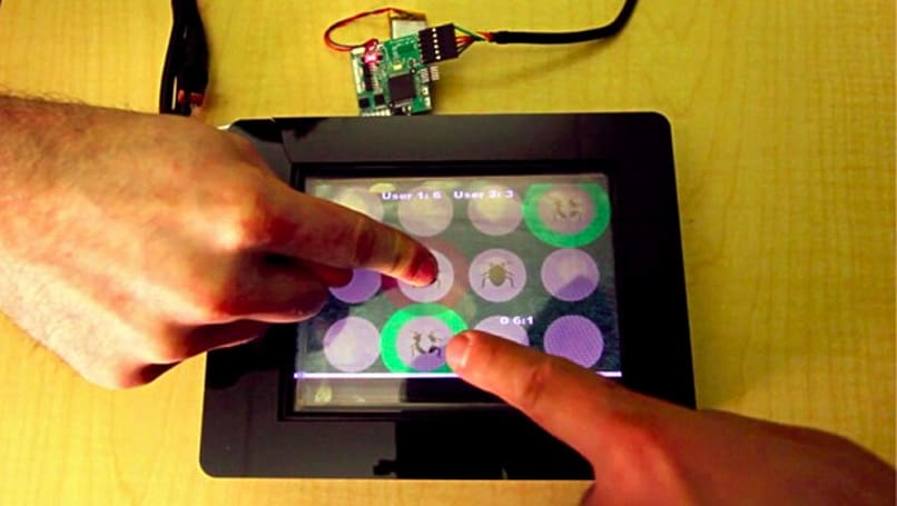 Disney Research develops capacitive touch that detects multiple users through their fingertips (video)