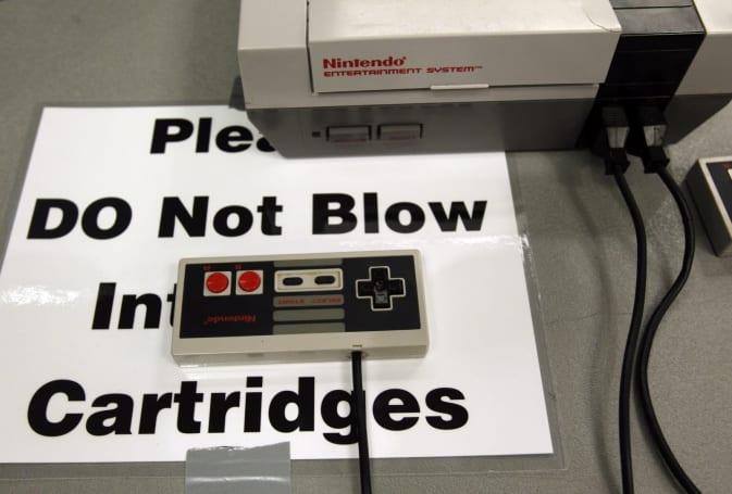 Nintendo's NES retrospective book looks like a game cartridge
