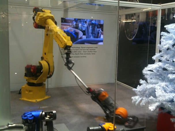 Industrial robot arm pretends to do chores in Dyson's London pop-up shop