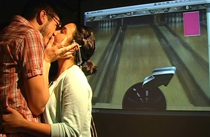 Kiss Controller lets you play a bowling game with your tongue... while it's in someone else's mouth (video)