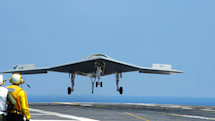 Navy drone plays well with manned aircraft, caps it with a carrier landing