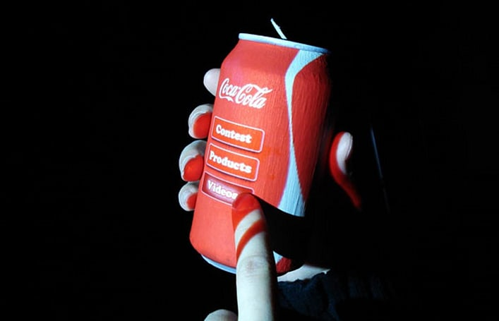 Non-planar devices promise downloadable hardware, interactive soda cans