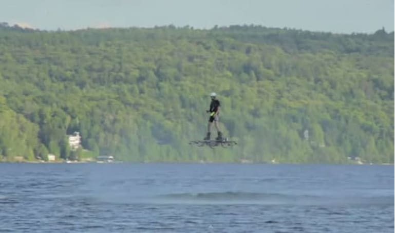 Guy hoverboards across a Canadian lake and into history