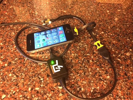 An iPhone being charged by a PowerPot V thermoelectric charger