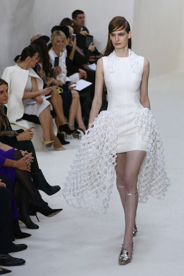 A model presents a creation for Christian Dior during the Haute Couture Spring-Summer 2014 collection show, on January 20, 2014 in Paris.   AFP PHOTO / FRANCOIS GUILLOT        (Photo credit should read FRANCOIS GUILLOT/AFP/Getty Images)
