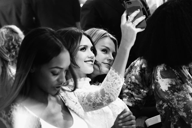 PARIS, FRANCE - FEBRUARY 26:  (EDITORS NOTE: Image converted to black and white)  Jessica Alba takes a selfie at the H&M show as part of the Paris Fashion Week Womenswear Fall/Winter 2014-2015 at Le Grand Palais on February 26, 2014 in Paris, France.  (Photo by Vittorio Zunino Celotto/Getty Images)