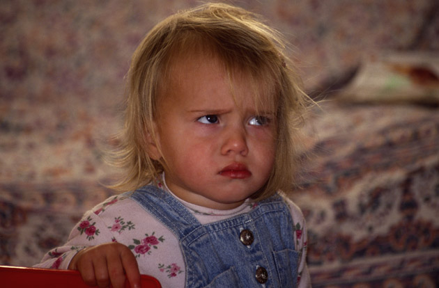 AHB0E1 Child with angry grumpy face. Image shot 2004. Exact date unknown.