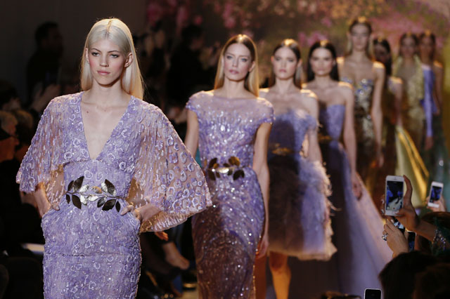 Models present creations by  Zuhair Murad during the Haute Couture Spring-Summer 2014 collection show, on January 23, 2014 in Paris.                  AFP PHOTO / PATRICK KOVARIK        (Photo credit should read PATRICK KOVARIK/AFP/Getty Images)
