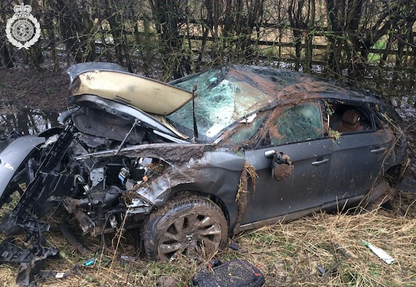 PIC BY WMAS / CATERS NEWS (PICTURED: THE CAR CRUSHED IN A DITCH IN WARWICKSHIRE) A driver who ended up in a ditch after his car flipped across the road has escaped with almost no injuries. The front of his car was destroyed in the collision that sent it flying across the A46 in Warwickshire SEE CATERS COPY