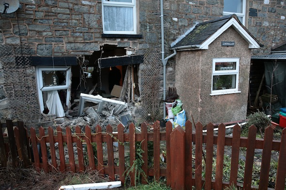 CASCADE NEWS ON BEHALF OF CAMBRIAN NEWS A man escaped with his life after a car smashed through his living room window while  he was watching football. David Hailwood was watching the Liverpool v Everton Derby last week when he heard a car speeding across his garden. Jumping out of his seat he heard a vehicle coming across the corner of his neighbourís garden. David, 66, said he leapt out of his seat next to the window and threw his friend out of harmís way - a split-second before the car crashed through shunting the sofa across the room.