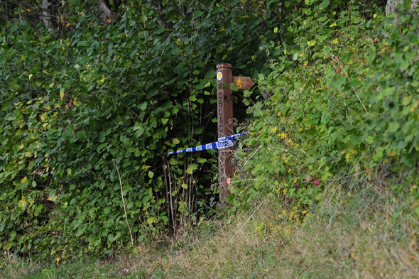 Police tape at the scene at Sweeney mountain near Oswestry in Shropshire, as they investigate the discovery of bones in the location.