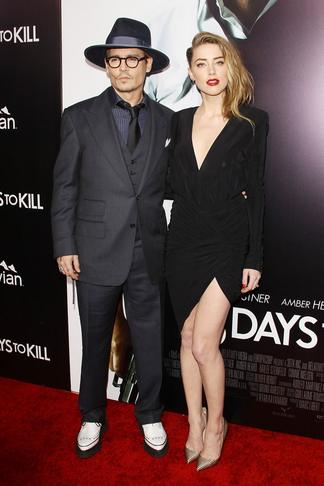 HOLLYWOOD, CA - FEBRUARY 12:  Johnny Depp (L) and Amber Heard arrive at the Los Angeles premiere of