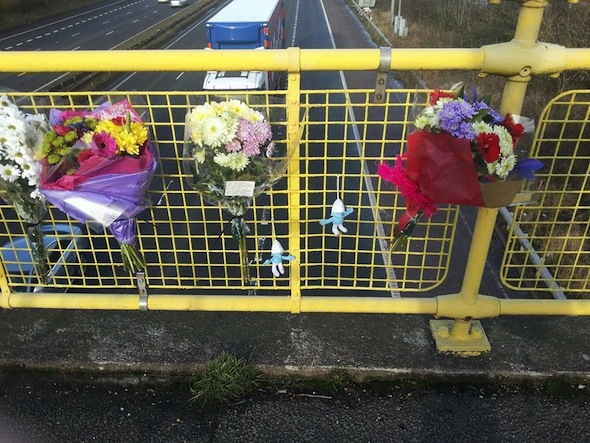 Facebook picture (taken from an open profile) of floral tributes to Aaron Cook at the scene where he jumped.  Lancashire police are appealing for witnesses to come forward after 16 year old Aaron Cook  died after falling from a bridge over the M6 motorway in Leyland, Lancashire before being hit by a vehicle that failed to stop. The incident took place around 11.30pm just past junction 28 on the M6 south at Leyland. He was seen to be stood on the wrong side of the footbridge when he fell into the carriageway. Four vehicles have swerved to avoid him but a fifth vehicle has collided with him as he lay in lane one of the carriageway. The driver failed to stop or report the incident. A 38 year old man from Stoke has been arrested on suspicion of causing death by dangerous driving and failing to notify police of an accident and is currently in police custody.
