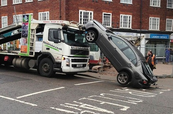 Driver Left Dazed After Reversing Vehicle Off The Top Deck Of A